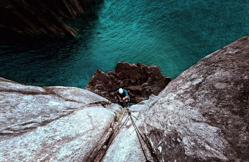 High Angle View Of Man Rock Climbing