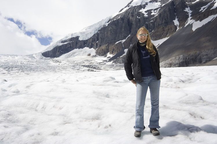 blond woman in the rockies - athabasca glacier, jasper national park, canada Athabasca Glacier Canada Cold Temperature Columbia Icefield Fun Glacier Happiness Happy Jasper National Park Mountain Mountain Range Mountains One Person One Woman Only One Young Woman Only Rocky Mountains Snow Snowcapped Mountain Sunglasses Vacations Warm Clothing Winter Woman Young Young Women