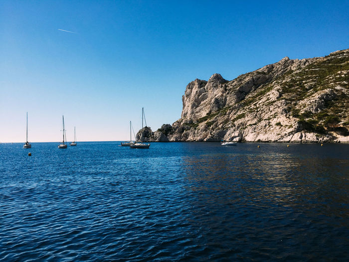 Yachting. Water Sea Sky Beauty In Nature Scenics - Nature Nautical Vessel Clear Sky Blue Tranquil Scene Tranquility Waterfront Nature Transportation Day No People Sailboat Mountain Idyllic Mode Of Transportation Outdoors Yacht Yachting Sailing