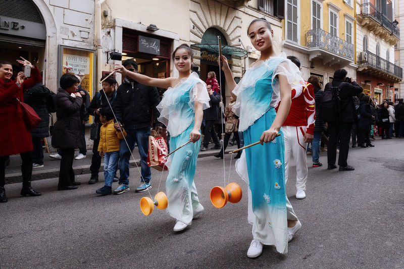 Rome, Italy - January 28, 2017: Celebration of the Chinese New Year in Rome, the year of the rooster. Juggler with yo-yo Adults Only Chinese Girls Chinese New Year Chinese Traditional Dress Day Full Length Human Body Part Juggling Outdoors Parade People Sport Women Yo-yo
