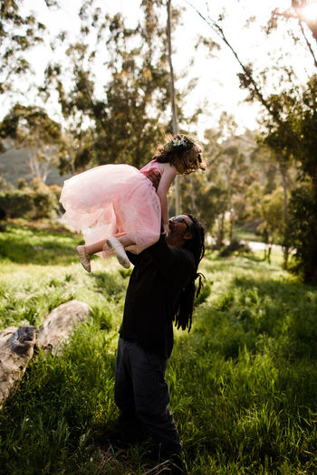 Side view of woman standing on pink land