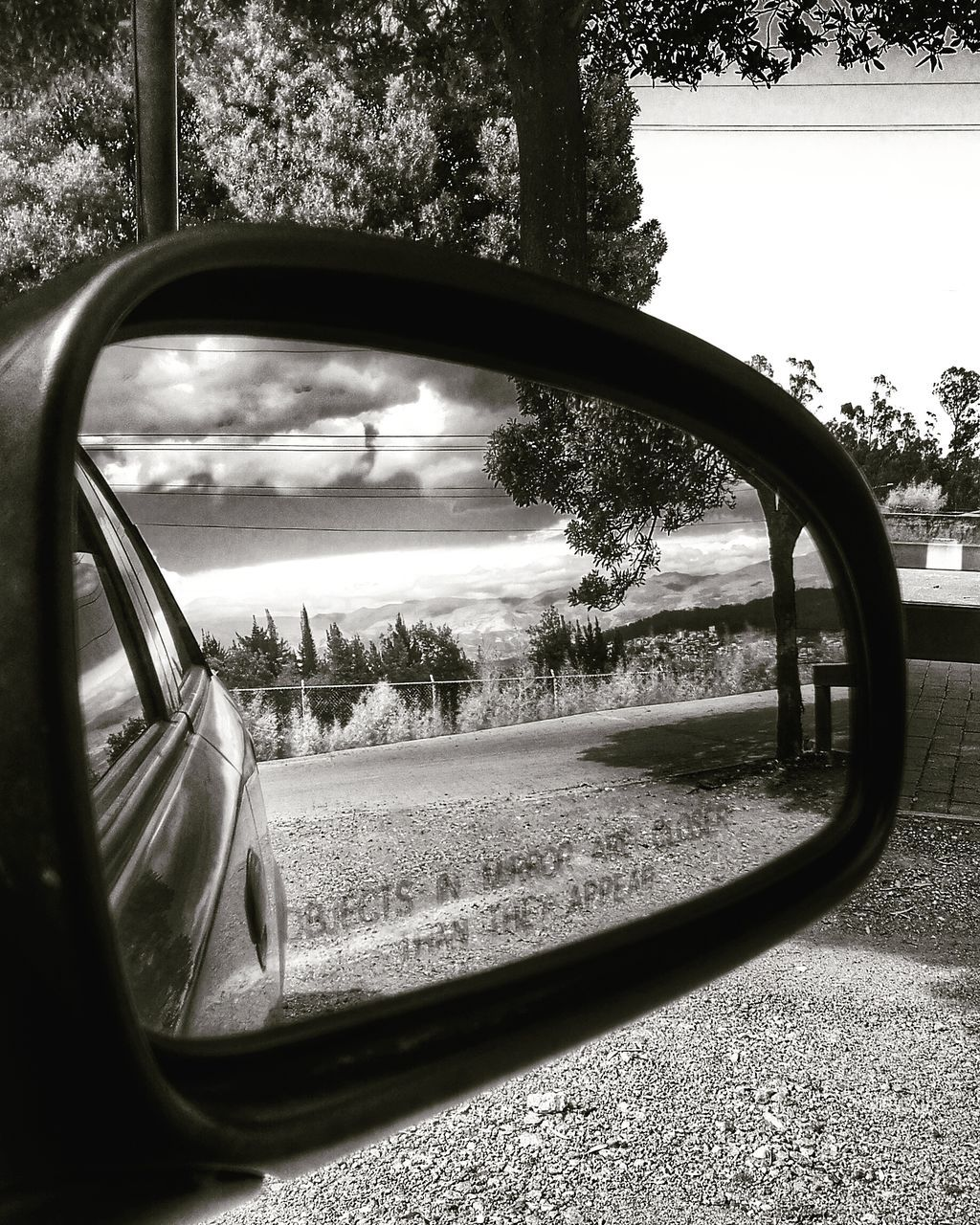 side-view mirror, tree, reflection, transportation, land vehicle, day, car, no people, vehicle mirror, road, nature, outdoors, sky, grass, close-up