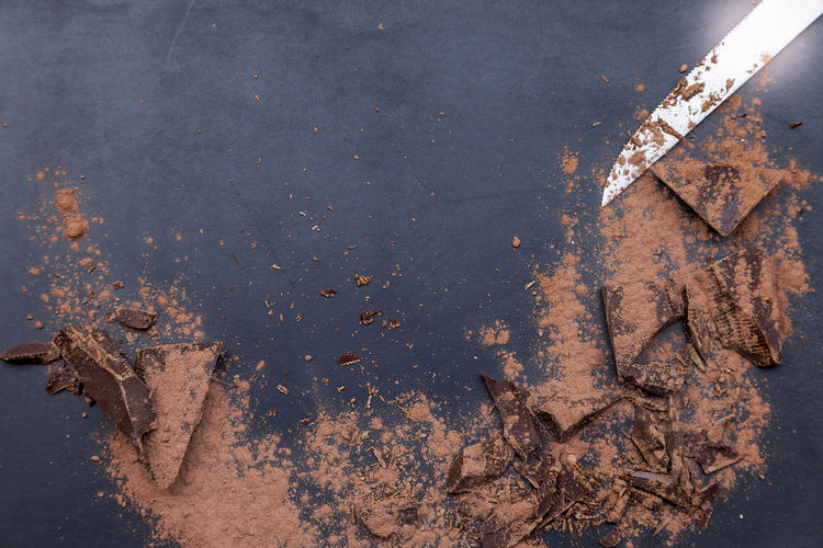 Directly Above Shot Of Chocolates And Cocoa Powder By Knife On Table