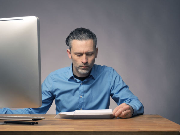 Businessman with a paper plane Business Businessman Computer Concentration Connection Day Desk Front View Indoors  Office One Person Paper Plane People Real People Sitting Start Start Up Success Table Technology Upswing Wireless Technology Working Young Adult