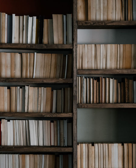 Bookcase with books, spines showing Shelf Indoors  Publication Large Group Of Objects Book In A Row Full Frame Bookshelf Backgrounds Education No People Order Abundance Arrangement Library Still Life Wood - Material Close-up Stack Collection Literature Hardcover Book