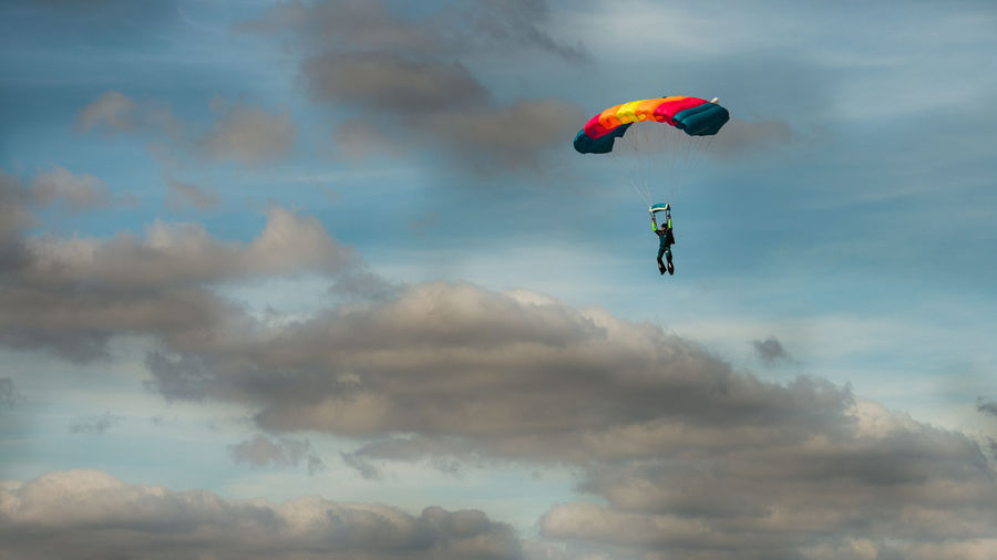 Adventure Cloud - Sky Day Exhilaration Extreme Sports Flying Leisure Activity Low Angle View Mid-air Multi Colored Nature One Person Outdoors Parachute Paragliding People Real People RISK Sky Skydiving Sport