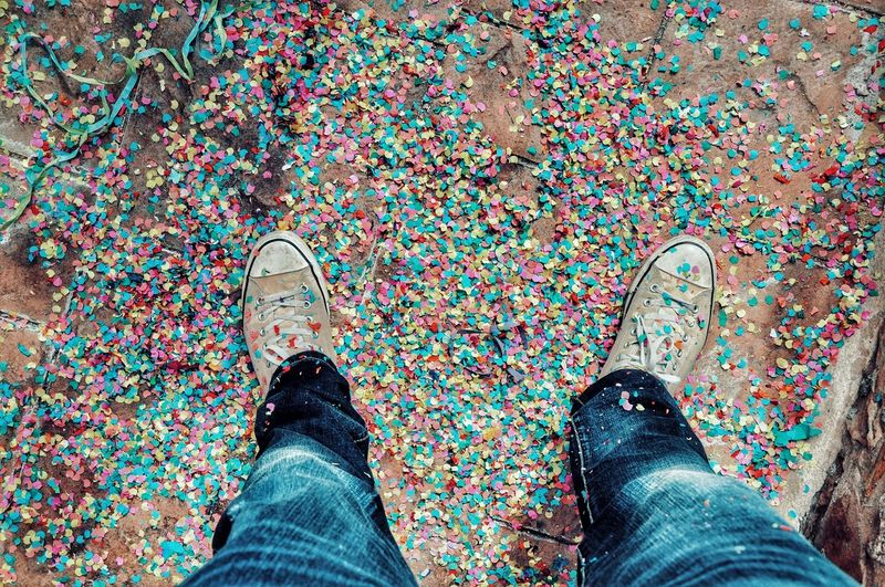 Low Section Of Man Standing On Confetti
