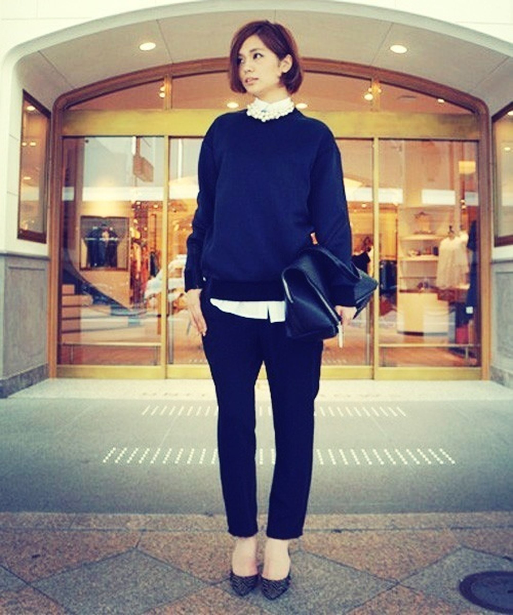 lifestyles, casual clothing, standing, indoors, front view, full length, young adult, person, leisure activity, young women, looking at camera, architecture, illuminated, portrait, three quarter length, built structure, fashion