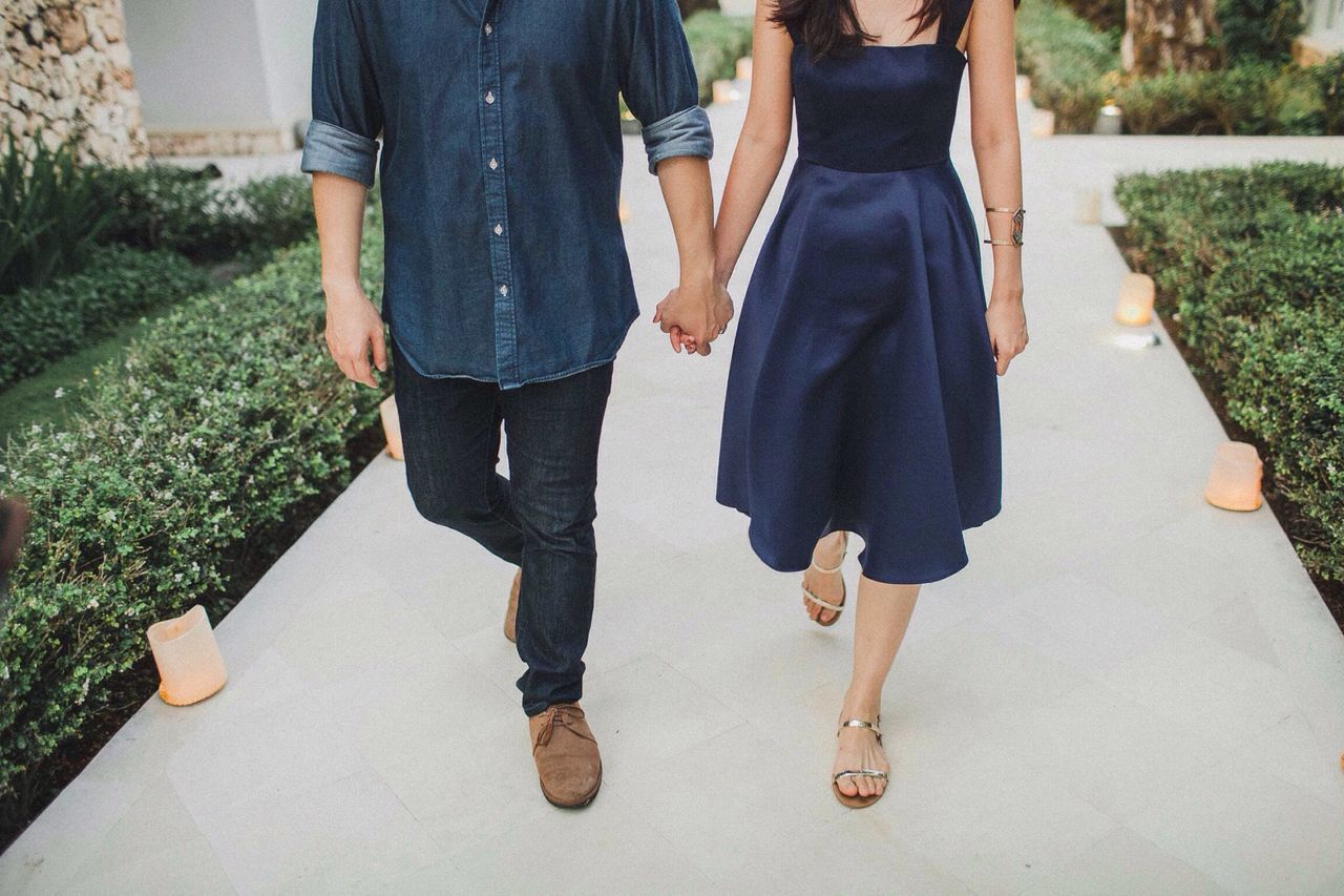 Low Section Of Couple Walking On Path