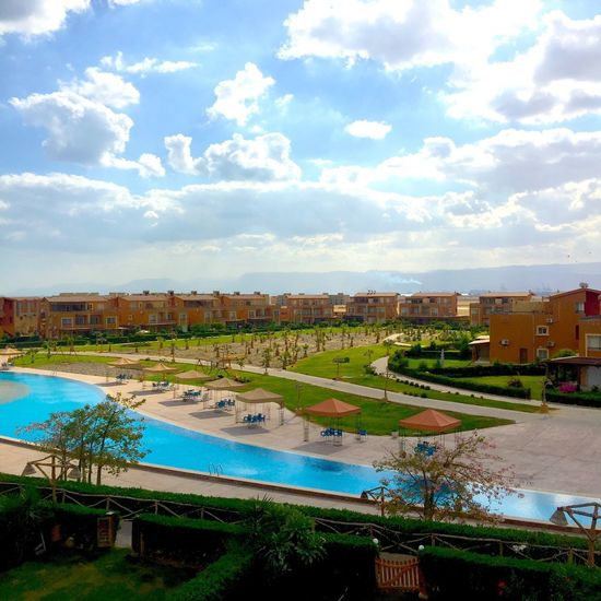 Ain Sokhna Egypt Architecture Building Exterior Sky Water Built Structure High Angle View Cloud - Sky Swimming Pool Day No People Outdoors City Nature Tree Cityscape