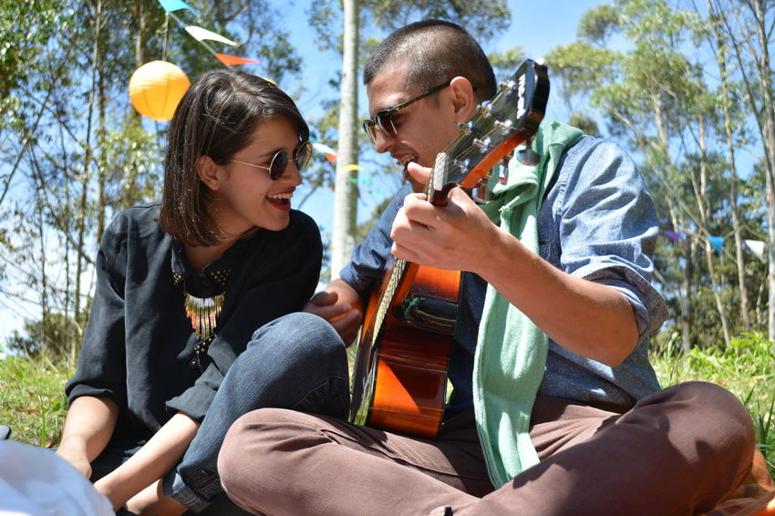 Casual Clothing Day Duo Enjoyment Family Friendship Fun Guitar Guitar Love Happiness Leisure Activity Lifestyles Music Outdoors Portrait Sitting Togetherness Tree