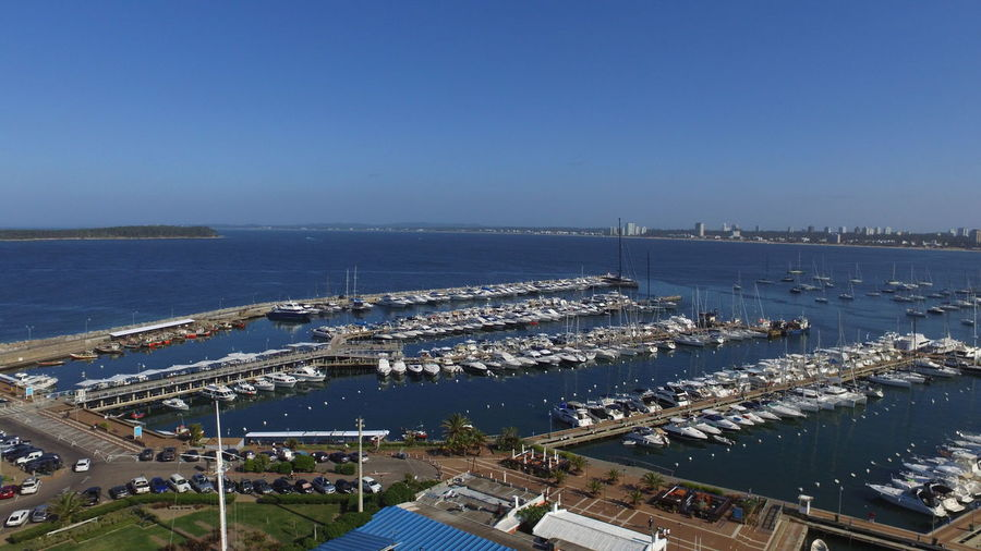 High angle view of harbor against clear blue sky