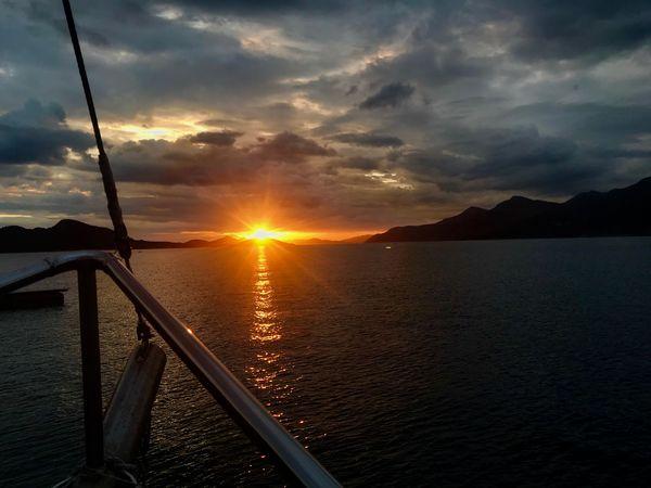 Sunset Sky Cloud - Sky Water Beauty In Nature Sun Scenics - Nature Nature Sea Sunlight Outdoors Idyllic Lens Flare