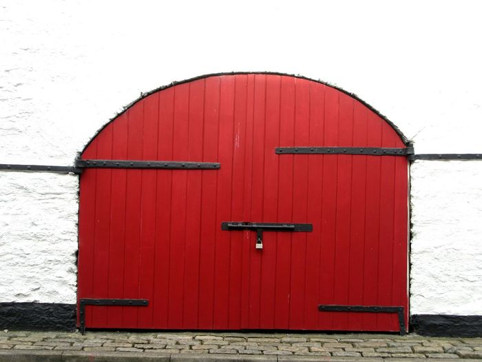 Recently painted red Door Closed Architecture Building Exterior Built Structure Red Safety Security Protection Entrance Vibrant Color Outdoors Façade 17th Century ıronwork Wooden Door Cobblestones Kinsale West Cork Wildatlanticway Ireland
