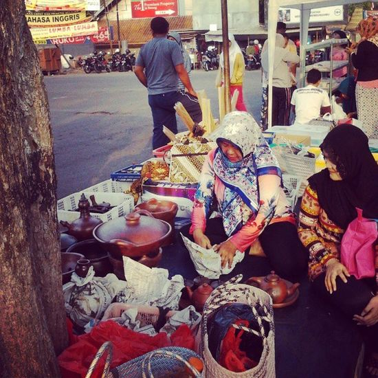 Another sunday stories. An earthenware seller offering teapot to my wife. Sunday Morning Stories Kotaserang Alunalun Serang Banten indonesia Handycraft