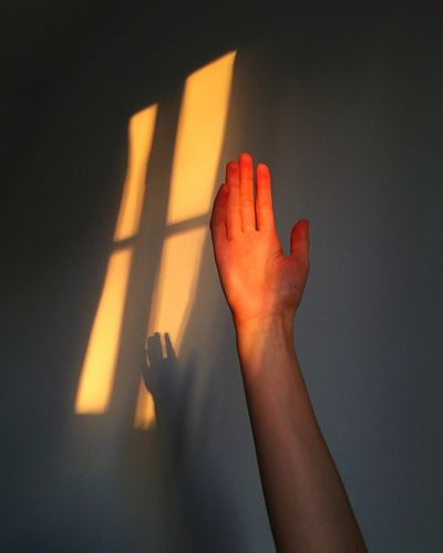Human Hand Human Body Part Real People One Person Leisure Activity Indoors  Women Illuminated Close-up Night People Hand Sunlight Glowing Glow Evocative Cornwall Emotions Tranquil Scene Tranquility
