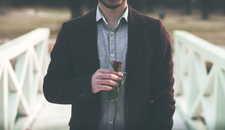 Close-up of a man holding rose