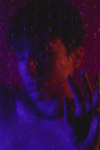 Defocused image of woman behind glass