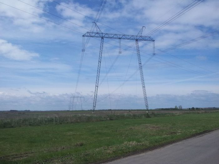 high voltage Cable Cloud - Sky Connection Day Electricity  Electricity Pylon Electricity Tower Fuel And Power Generation Grass Landscape Nature No People Outdoors Power Line  Power Supply Sky Technology