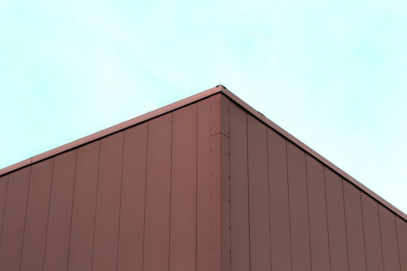 Low angle view of warehouse against sky