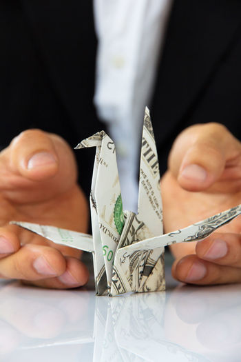 business man hand holding origami paper cranes, money concept Abstract Photography Business Conceptual Art Abstract Abstract Art Business Concept Business Finance And Industry Businessman Close-up Concept Conceptual Conceptual Photography  Day Finance Financial Financial Item Human Body Part Human Hand Indoors  Money Origami Cranes Origami Paper Origamiart Paper Currency Wealth