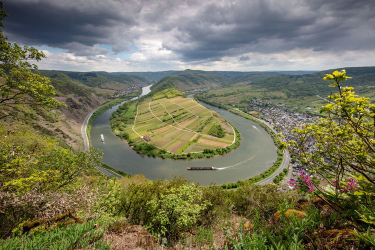 Mosel horse shoe bow in Bremm with view to Edinger-Eller, Rheinland-Pfalz, Germany, May 2019 Germany Mosel Cloud - Sky Environment Beauty In Nature Scenics - Nature Plant Landscape Sky Nature Tranquil Scene Day Tranquility Green Color No People Land Non-urban Scene High Angle View Road Outdoors Bremm Bremm An Der Mosel Bremmer Calmont