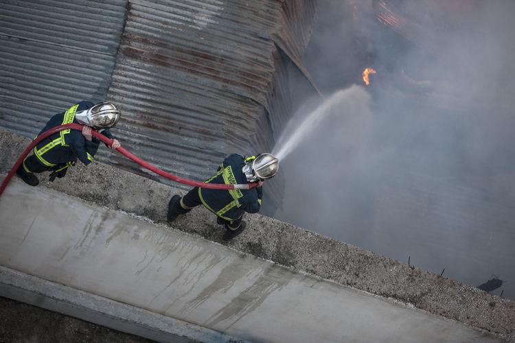 Firemen extinguishing fire