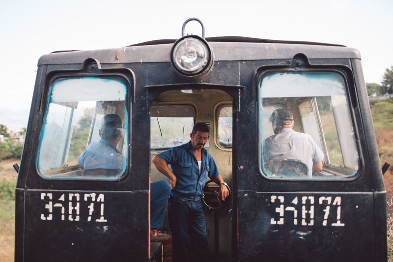 Portrait of a young man in bus