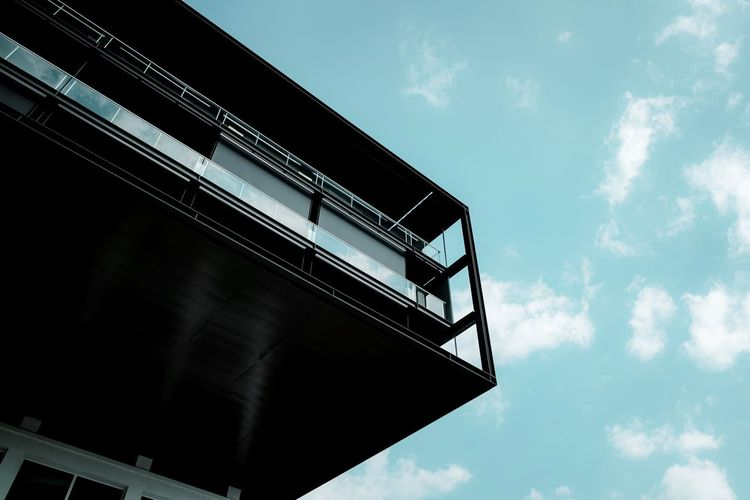 Urban Perspectives Architectural Feature Street Photography The Devil's In The Detail Architectural Detail Apartment Buildings Sky Low Angle View Architecture Built Structure Cloud - Sky Day Building Exterior No People Outdoors Building Metal Window Railing Sunlight Modern Protection Safety Apartment Balcony Urban Geometry Minimalism The Architect - 2019 EyeEm Awards The Minimalist - 2019 EyeEm Awards My Best Photo