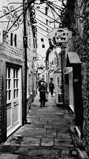 Cobbled street Blackandwhite Cobbledstreet Skipton Yorkshire England, UK Flags Worldflags Shopping Walking Architecture Building Exterior Built Structure Alley Cobblestone Old Town Building Historic Exterior Pathway Walkway