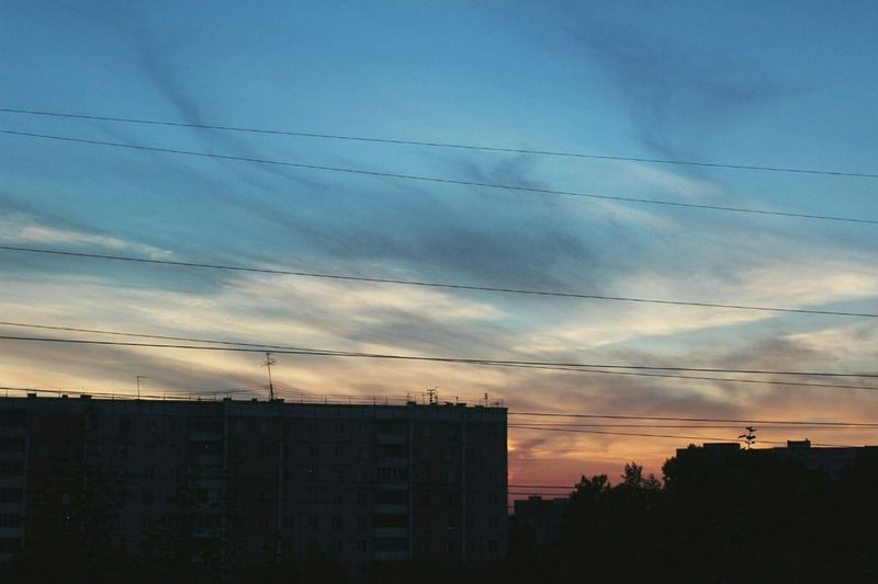 небо Blue Cloud Architecture Built Structure Silhouette Building Exterior Low Angle View Sky Sunset Power Line  Cloud - Sky City Cloud Cable Blue Outdoors Cloudy Power Supply Scenics No People Outline First Eyeem Photo