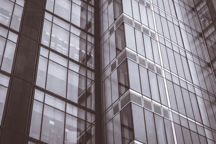 Low angle view of glass building in city