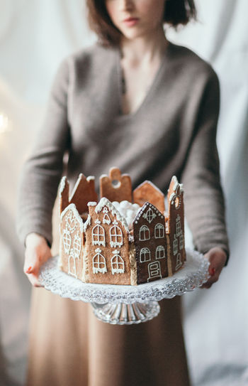 One Person Women Adult Holding Front View Indoors  Celebration Cake Sweet Food Dessert Gingerbread Gingerbread House Christmas Christmas Decoration Baked Pastry Item Icing Homemade Cake