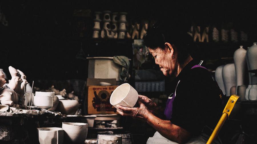 baked clay in Ratchaburi Thailand Crafts Craftsman Mold Ratchaburi, Thailand Thailand Baked Clay Craftsman Working Craftsmanship  Craftsperson Day Indoors  Ratchaburi