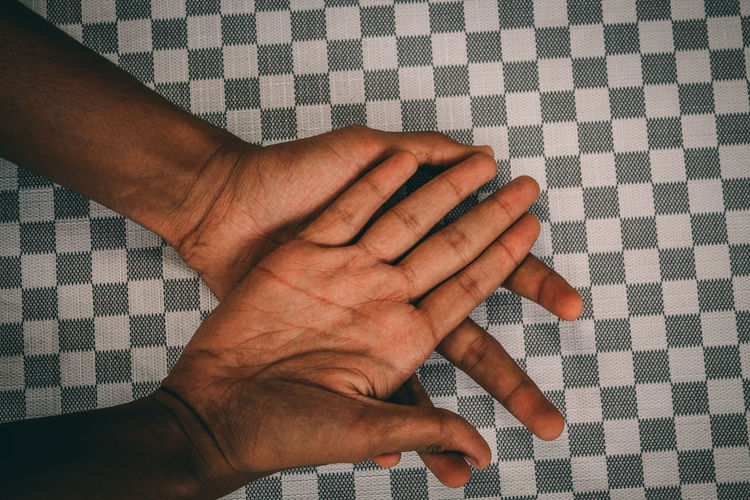 Cropped image of hands on table