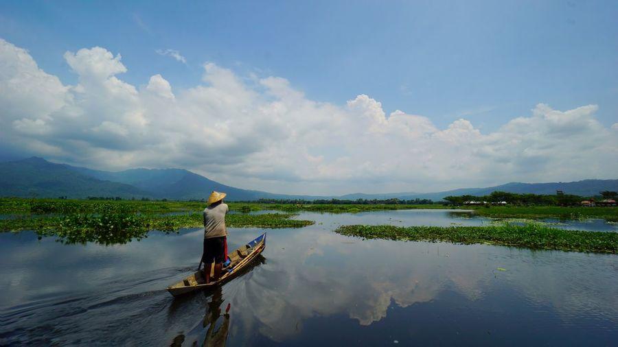 Rawa Pening lake view. Outdoors Reflection Lake Cloud - Sky Water Landscape Scenics One Person Beauty In Nature Travel Travel Photography Travel Destinations Jawa Tengah, Indonesia Ambarawa, Indonesia