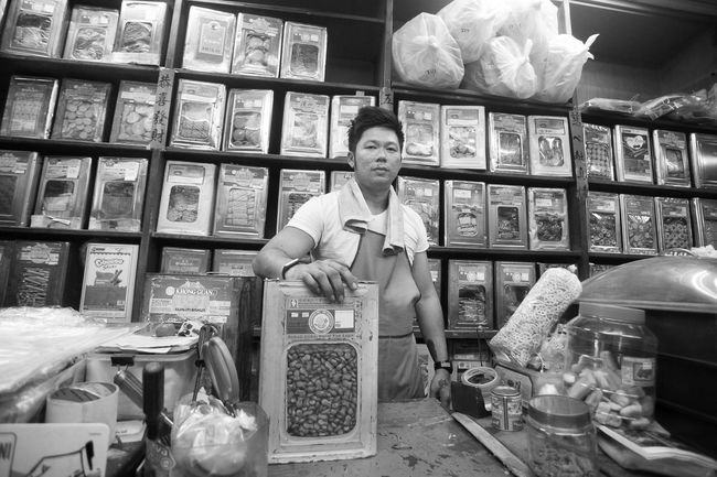 Biscuit seller EyeEm Portrait Taking Photos Life Enjoying Life Portraits Photography Malaysia Potrait Photojournalism First Eyeem Photo Photography ♥ Eye4photography  Malaysian Pulau Pinang Growing Better Pulaupinang The Traveler - 2015 EyeEm Awards The Photojournalist - 2015 EyeEm Awards The Photojournalist The Traveler-2016 Awards Blackandwhite Black And White Monochrome Blackandwhite Photography