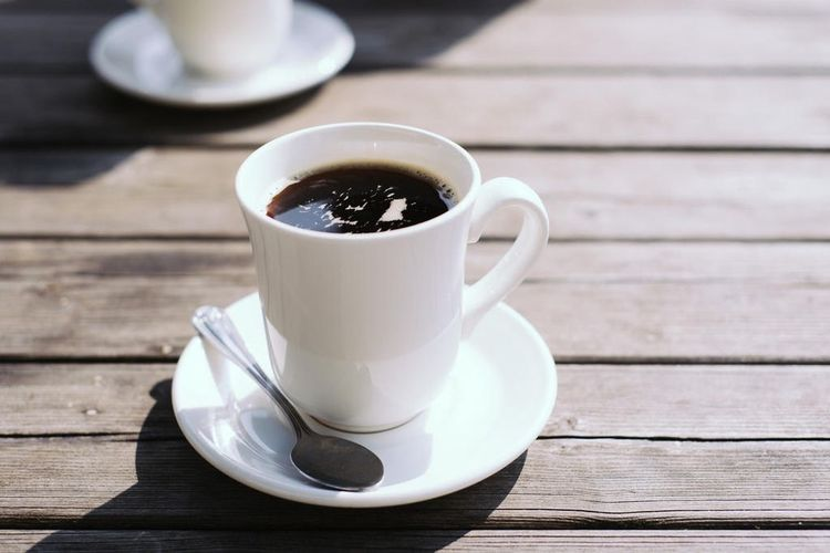 Close-Up Of Black Coffee On Wooden Table
