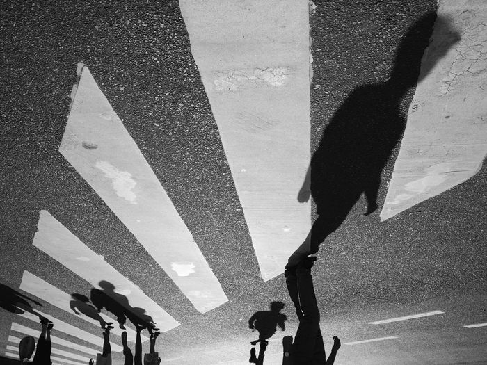 Road Road Marking Street Walking Transportation Zebra Crossing Low Section Person Shadow Crosswalk Crossing Men Pedestrian Adult Togetherness City Life Day Outdoors Limb Streetphotography Everybodystreet Black And White Monochrome Photography The Street Photographer - 2017 EyeEm Awards Break The Mold