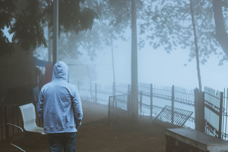 Roads untravelled ... Adult Casual Clothing People One Person Only Men Rear View Hooded Shirt Outdoors Standing Men Young Adult Fog Tree Sky Tamilnadu Kodaikanal Taking Photos Nature Tadaa Community Weather Freshness Real People Tourism Day Mist