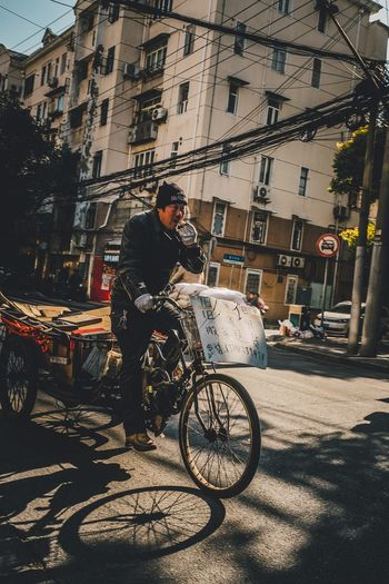 Man cycling on bicycle in city