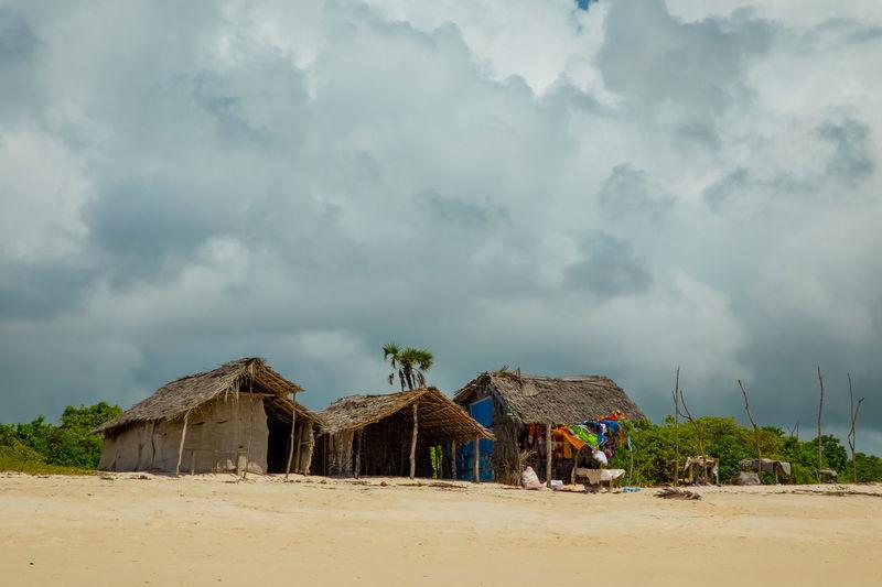 Built structure on beach against sky