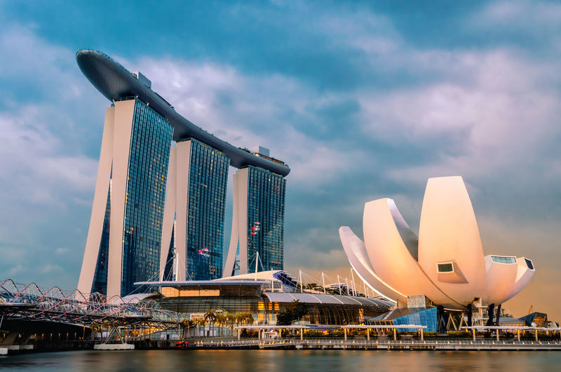 SINGAPORE-Jan 18, 2018: A beautiful view of Marina Bay Sands along with ArtScience Museum. Beautiful Infinity Pool Marina Bay Sands Singapore Travel Photography Architecture Backgrounds Bay Building Built Structure City Cityscape Cloud - Sky Famous Place Hotel Hotel Room Luxury Modern Outdoors Skyscraper Travel Travel Destinations Wallpaper Water Waterfront