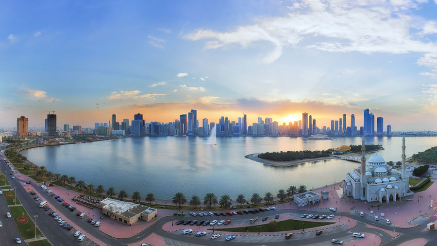 Panoramic Sunset for Khaled lake in Sharjah Panorama Sharjah Architecture Building Exterior City City Life Cityscape Cloud - Sky Clouds Masjed  Modern No People Outdoors Sky Skyline Skyscraper Sun Sunset Tower Travel Destinations Water