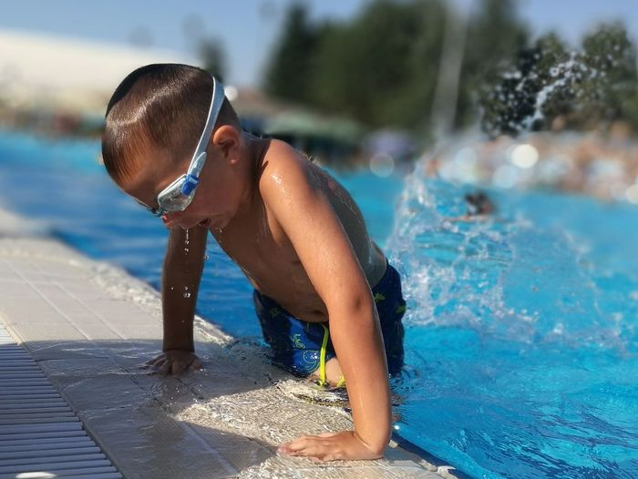 Kids Kid Kidsphotography EyeEm Selects Water Swimming Athlete Swimming Pool Time Sport Smiling Summer Aquatic Sport Wet
