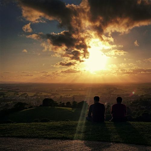 Caught a quiet moment between a father and his son watching the sunset from Glastonbury Tor Sunset Quiet Moments Creative Light And Shadow First Eyeem Photo Photography Photooftheday Nature Photography Bestseatsinthehouse Memories