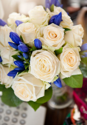 Ecru roses wedding bouquet with blue flowers in vertical orientation, nobody. Blue Bouquet Bridal Bunch Bunch Of Flowers Cut Ecru Flower Flowers No People Nosegay Posy Rose - Flower Roses Wedding White