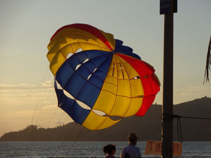 Tourists preparing for kite boarding