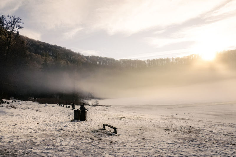 Ice Wintertime Beauty In Nature Cold Temperature Day Foggy Morning Forest Frozen Lake Landscape Mountain Nature Outdoors People Scenics Sky Snow Sunset Tree Weather White Color Winter Shades Of Winter