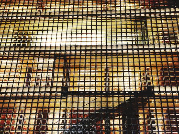 Full frame shot of metal grate window